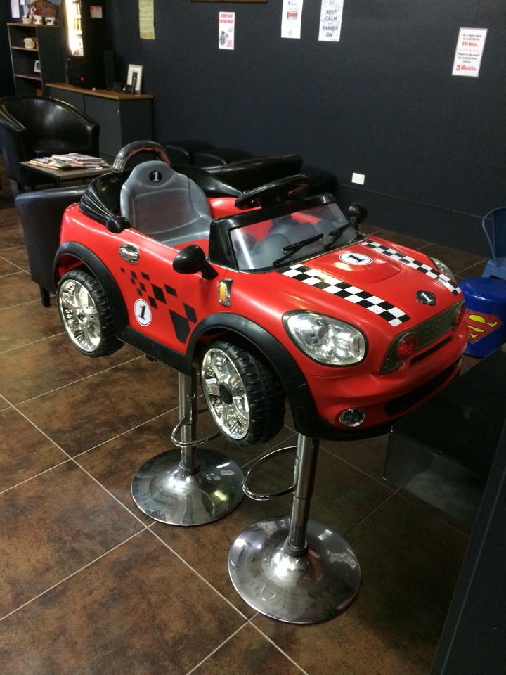 Kids Cutting Chair - Big Red Barbers Chair & Ally Barber Cairns | The fun and friendly barber in Redlynch